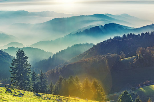 Scenic mountain landscape. View on Black Forest in Germany, covered in fog. Colorful travel background.