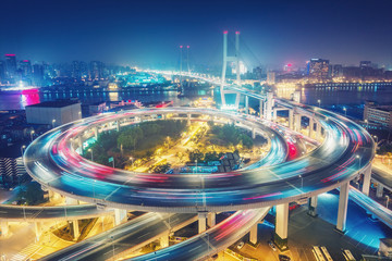 Tuinposter Aziatische Plekken Scenic view on famous bridge in Shanghai, China at night. Multicolored nighttime skyline. Travel background.