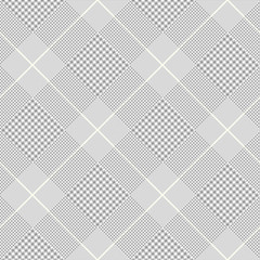 Seamless Prince of Wales check pattern in gray, white and pale golden cream.