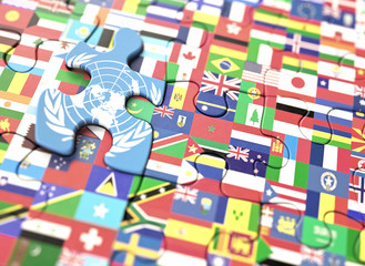 Concept puzzle with several flags of the world and United Nations in highlighted piece.