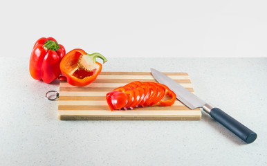 Bulgarian pepper on a cutting Board with a knife.