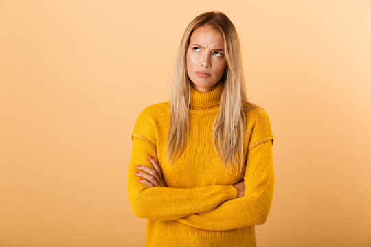 Portrait of an upset young woman dressed in sweater
