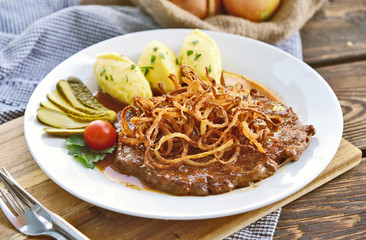 onion-topped roast beef with gravy and Potatoes puree is the favorite dish in Austria. (German name is Zwiebelrostbraten) Beef,potatoes and onion menu in European style.
