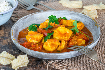 Fish Mappas - Kerala style coconut fish curry with rice. It's a popular dish in southern Indian state of Kerala.