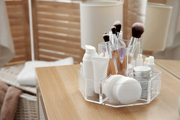 Organizer with cosmetic products and space for text on dressing table