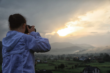 Professional nature photographer taking photos in mountains