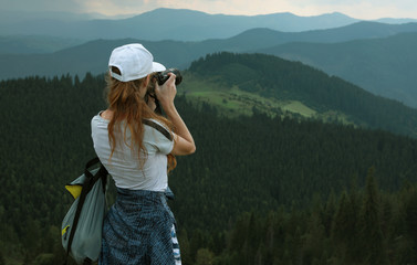 Professional nature photographer taking pictures in mountains. Space for text