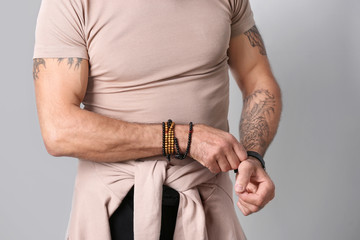 Closeup view of tattooed man on white background