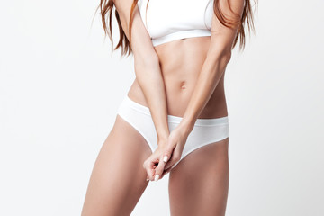 Sexy young woman in underwear on white background