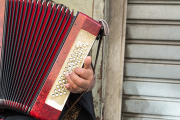 Close Up of Old Beggar Woman Playng a Dirty Accordion in the Street