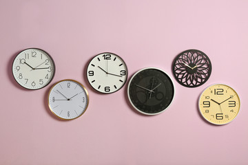Different clocks on color background. Time management