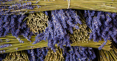 Bunches of dry lavender and healthy spa lifestyle stall at organic farmer market in Provence, France.