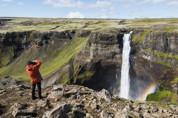 Photographer taking picture of Haifoss waterfall, Iceland