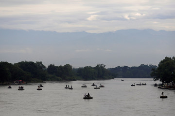 Rafts cross the Suchiate River to avoid the border checkpoint in Ciudad Hidalgo