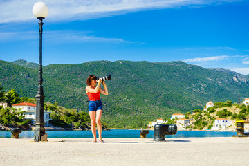 Woman taking pictures during holiday in Greece