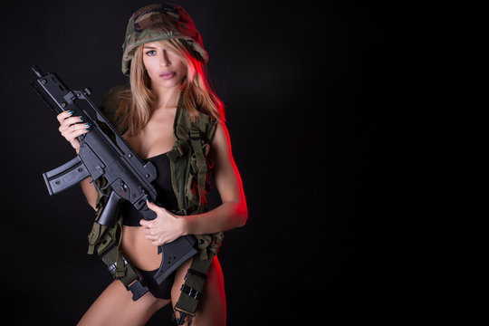 Wounded woman warrior. Sexy woman in military clothes.