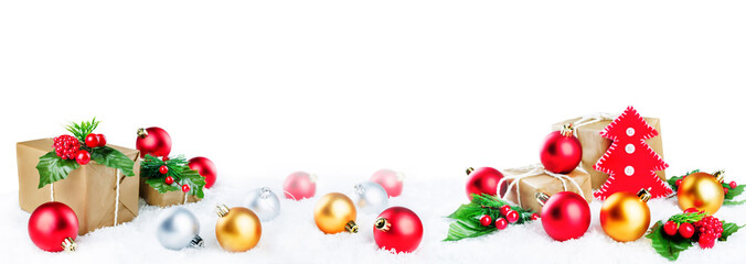 Christmas lantern with gifts, colored balls and Santa Claus on snow isolated background