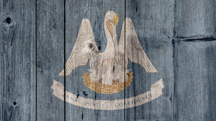 USA Politics News Concept: US State Louisiana Flag Wooden Fence