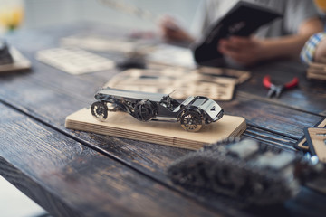 Detailed toys. Unusual metal mechanisms being placed on the table looking laconic and detailed