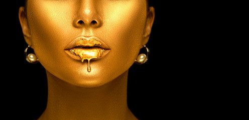 Poster Fashion Lips Gold paint drips from the sexy lips, golden liquid drops on beautiful model girl's mouth, creative abstract makeup. Beauty woman face isolated on black background