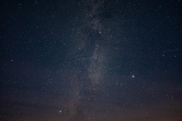 Starry sky through the clouds
