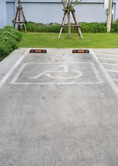 Disabled parking sign for handicapped only against car parking