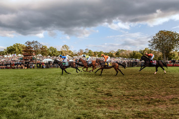 Horses race during the 98th Running of the Far Hills Race Meeting at Mooreland Farm in Far Hills