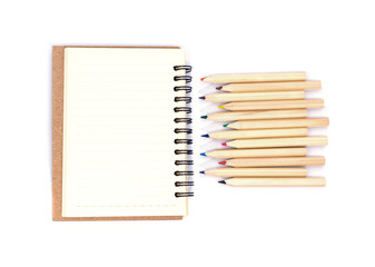 Top view open notebook and crayon isolated on white background.