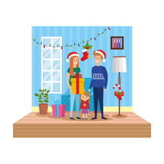parents with daughter in livingroom with christmas decoration