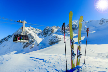 Wall Mural - Ski in winter season, mountains and ski touring backcountry equipments on the top of snowy mountains in sunny day, Verbier Switzerland.