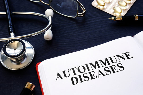 Autoimmune diseases. Book, pills and stethoscope on the desk.