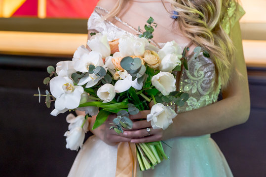 the bride is holding a beautiful bouquet, weddin