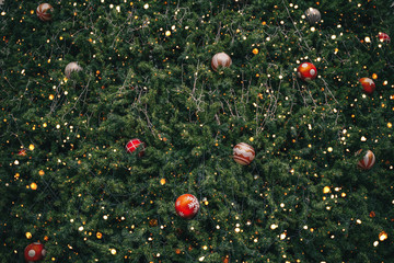 Wall Mural - Vintage Christmas tree with ball decoration and sparkle light filter effect. Christmas and New Year holiday background. vintage color tone.