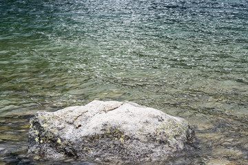 wet stone by lake shore