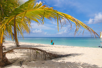 Lady on the caribbean beach, beautiful view, Cozumel