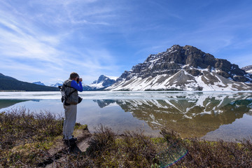 A Man Photographing Bow Lake, Alberta, Canada
