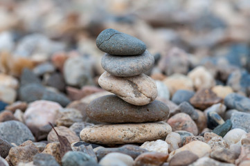 Small balancing stones sitting on other rocks