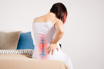 Fototapeta Pain in the spine, woman with backache at home, injury in the lower back obraz