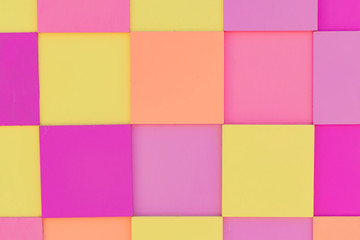 Multicolored wooden panel in pink, yellow and orange pastel colors for background