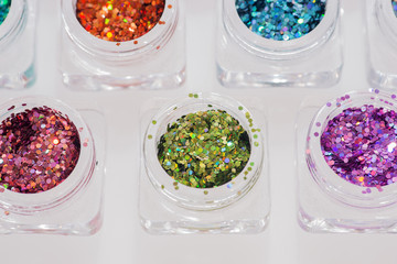 Different colored glitters in transparent jars