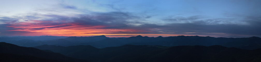 High resolution colorful sunset panorama, silhouette of the Chornohora mountain range of the Carpathians, Ukraine