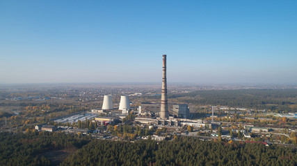 The thermoelectric plant with big chimneys in forest