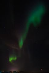 amazing aurora borealis activity or northern lights above ekkeroy island