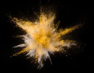 Fototapete - Explosion of yellow powder on black background