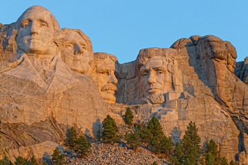 Mount Rushmore sculptures of Four United States Presidents at the sunrise