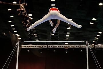 Door stickers Gymnastics back gymnast exercise on horizontal bars in gymnastics