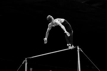 exercise on horizontal bars athlete gymnast black and white photo
