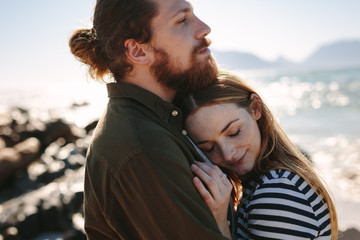 Affectionate couple embracing outdoors on beach