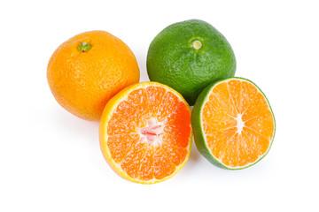 Whole and halves ripe green tangerine and ordinary mandarin orange