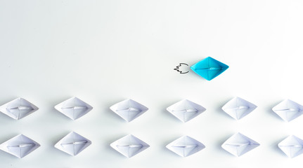Blue paper ship are different from others on white background. Business for Innovative, solution and different vision concepts.